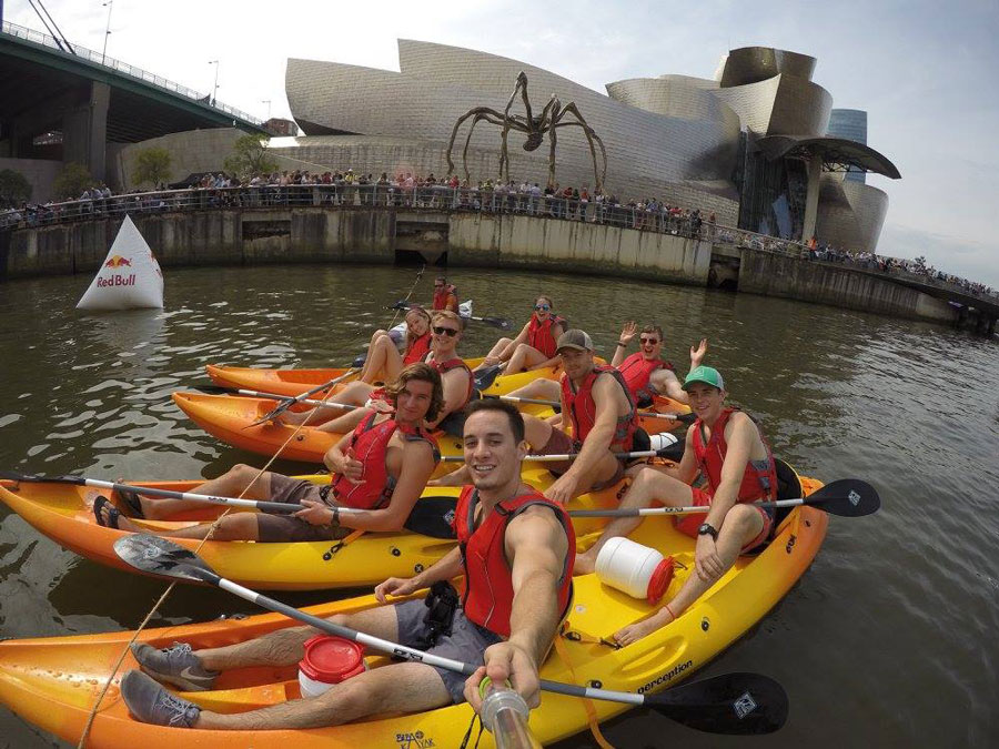 Students kayaking in front of the Guggenheim in Bilbao, Spain during a study abroad program with USAC