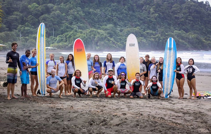 study abroad students prepare to go surfing during a study abroad in Costa Rica