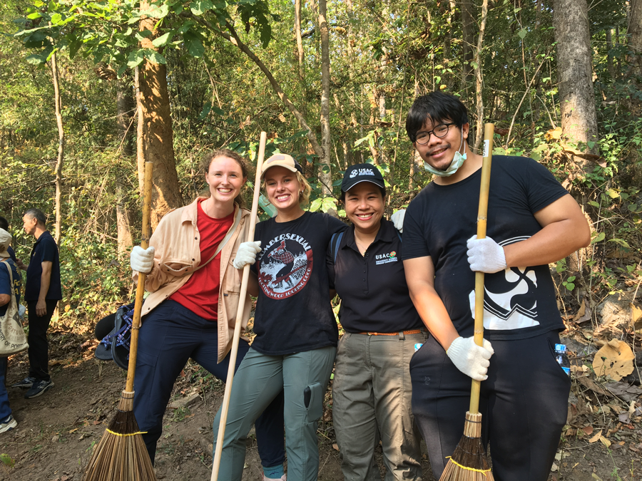Students in Chiang Mai, Thailand volunteer to help build a firebreak during study abroad