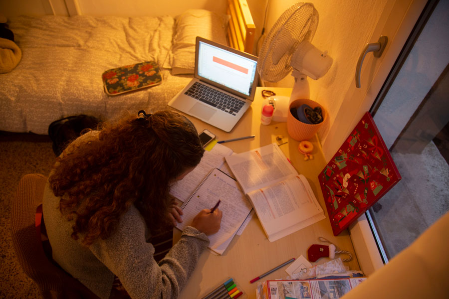 A student participates in online language courses from her home