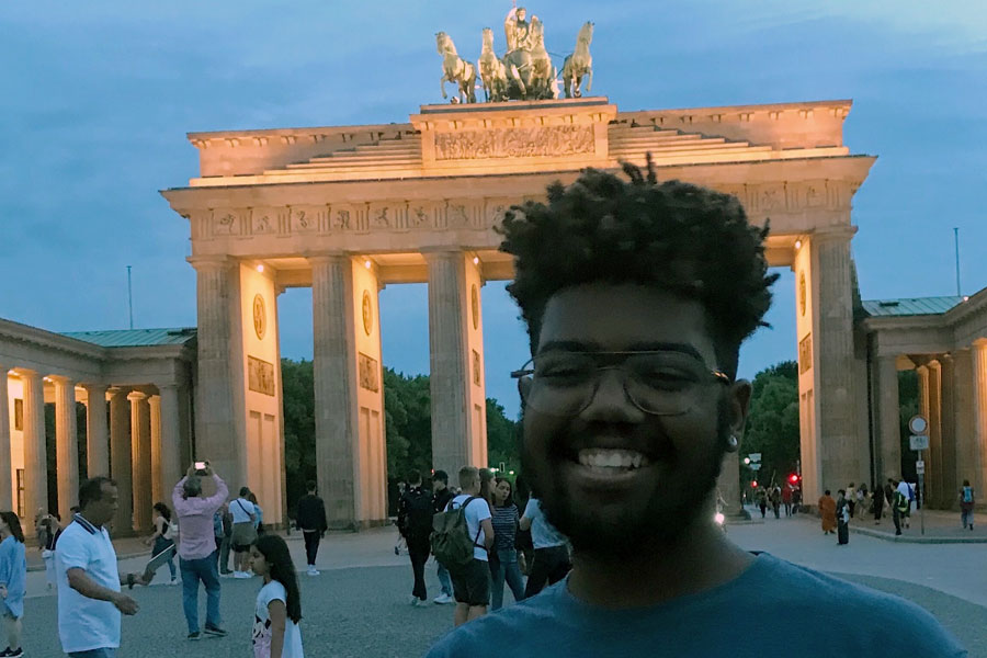 A black student standing in Berlin during a study abroad