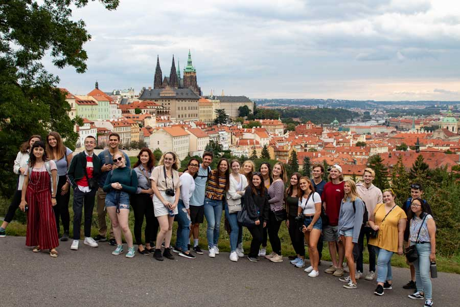 A group of students pose for a photo during a study abroad in Prague with USAC