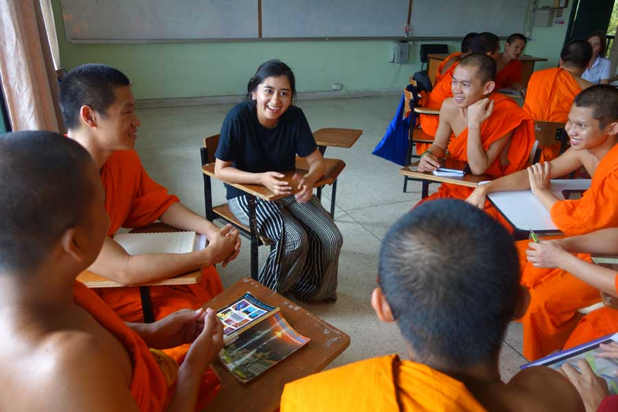 A USAC student speaks with local monks during a study abroad in Chiang Mai, Thailand