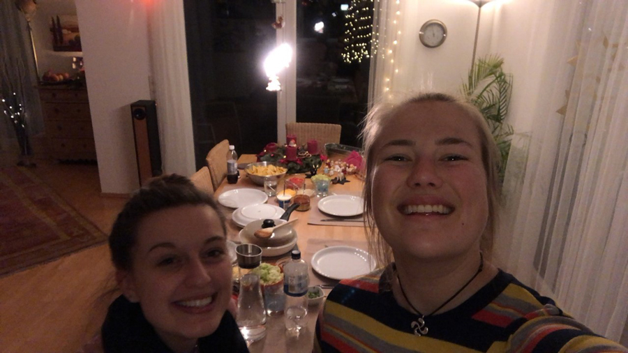 Two students studying abroad in Europe cook dinner for their host family