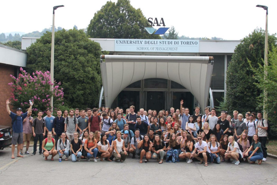 USAC students take a picture on their host university campus, SAA.