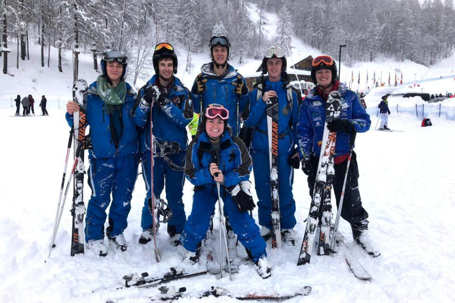 Students pose for a picture on the ski hill.
